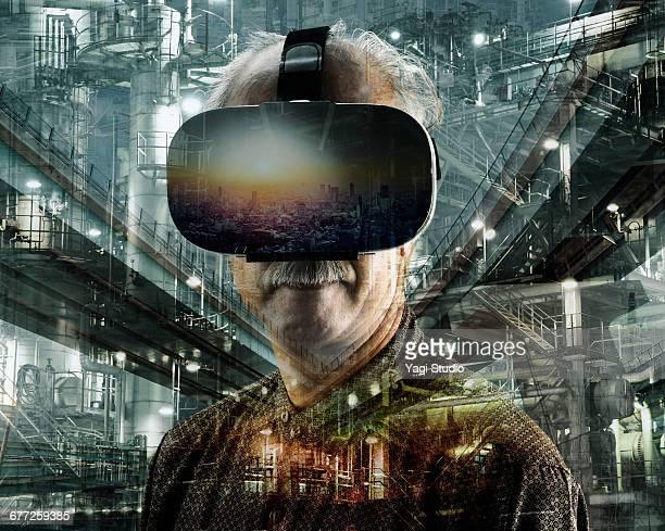 Senior man using a virtual reality headset.