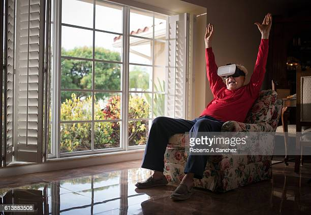 Senior man using a VR set