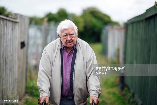 senior man using mobility walker - senior adult stock pictures, royalty-free photos & images