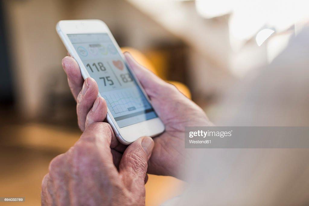 Senior man using smart phone app : Stock Photo