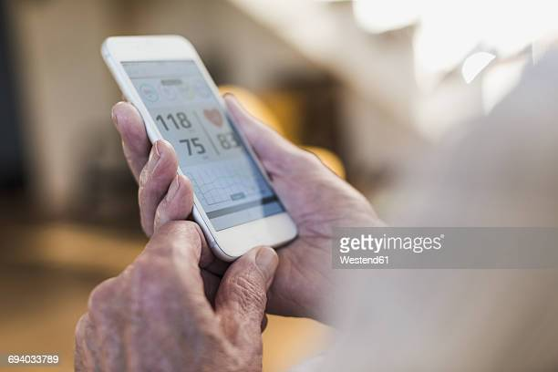 Senior man using smart phone app
