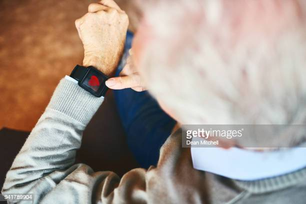 senior man using smartwatch with fitness app - heart health stock pictures, royalty-free photos & images