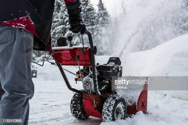 senior man using snowblower after a snowstorm - snowplow stock pictures, royalty-free photos & images