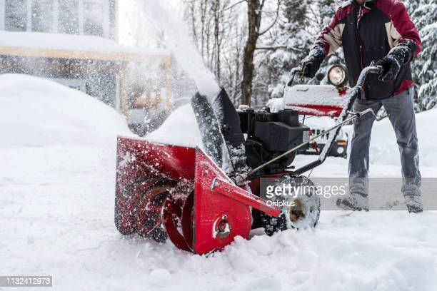 senior man using snowblower after a snowstorm - strip stock pictures, royalty-free photos & images