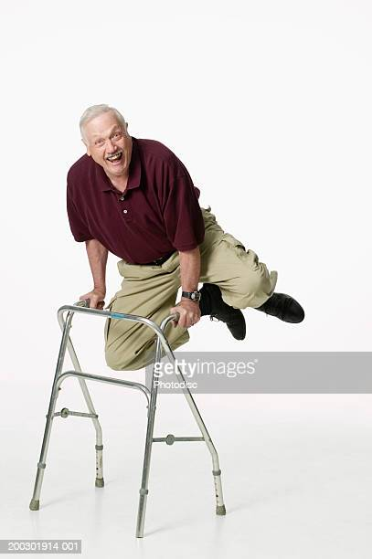 senior man using walker, jumping and clicking heels - old man feet stock pictures, royalty-free photos & images