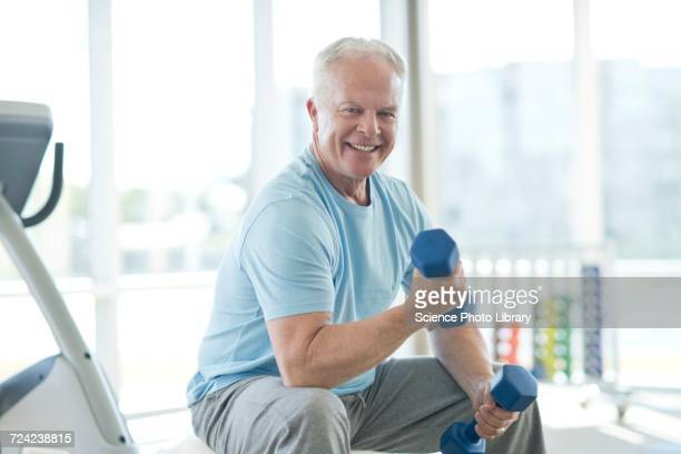 senior man using weights - hand weight stock pictures, royalty-free photos & images