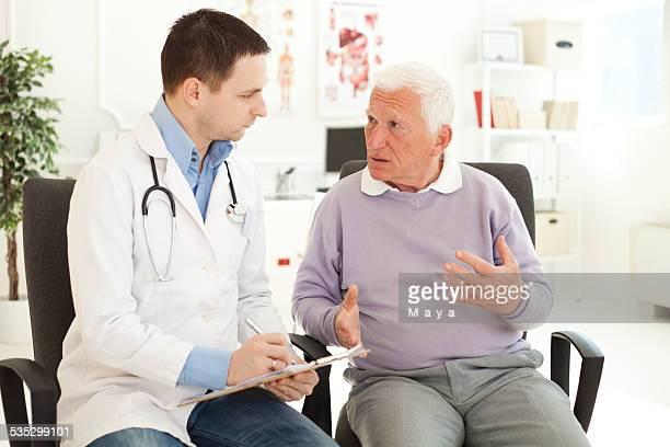 Senior man visiting doctor.