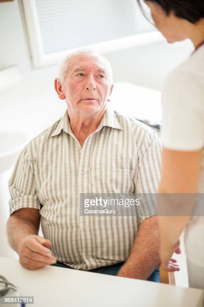 Senior Man Visiting Doctor's Office In The Retirement Home For A Check-Up