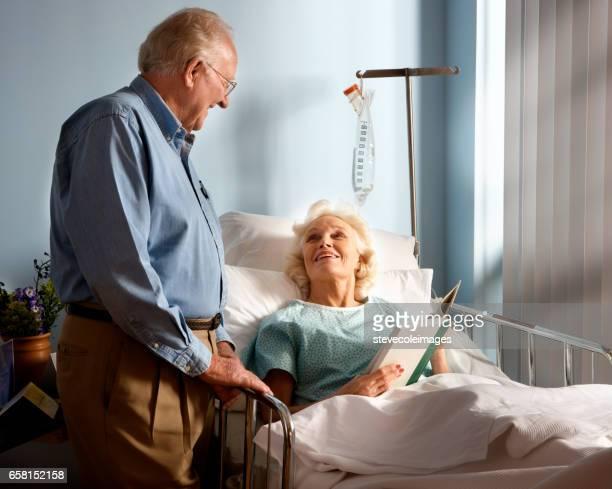 Senior man visiting wife at hospital.