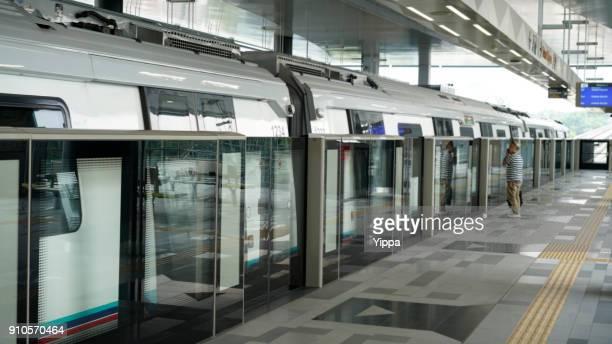 Senior man waiting on MRT platform, Kuala Lumpur, Malaysia