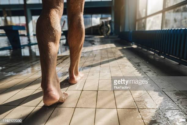 senior man walking near swimming pool - old man feet stock pictures, royalty-free photos & images