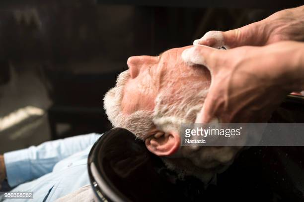 senior man washing his hair - hairstyle stock pictures, royalty-free photos & images
