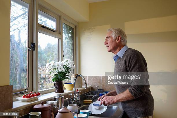 Senior man washing up.