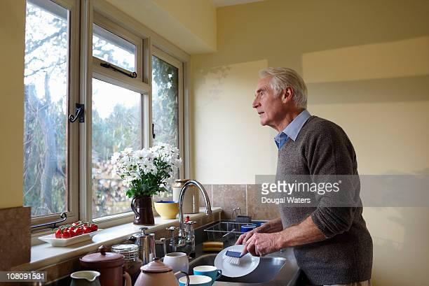 Senior man washing up.