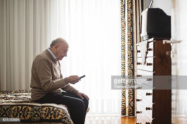 Senior man watching television