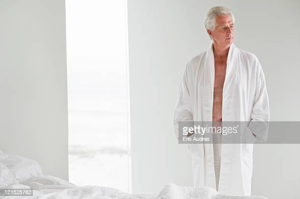 senior man wearing a bathrobe - bathrobe stock pictures, royalty-free photos & images