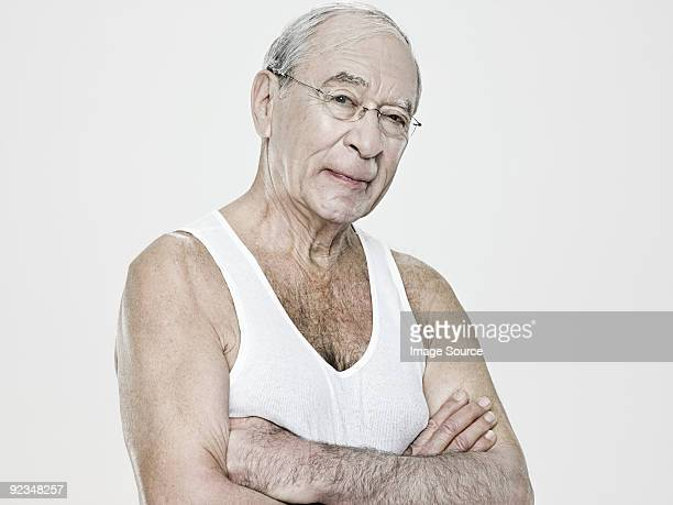 uomo anziano con un gilet - canotta foto e immagini stock