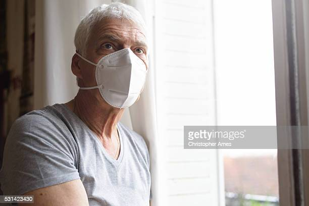 Senior Man Wearing Air Filter Mask