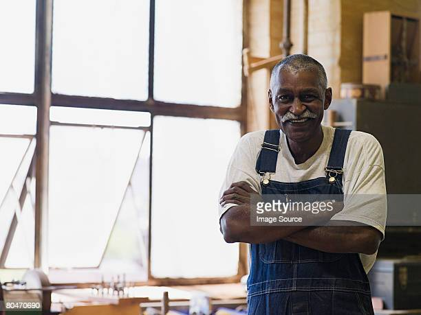 senior man wearing dungarees - bib overalls stock pictures, royalty-free photos & images