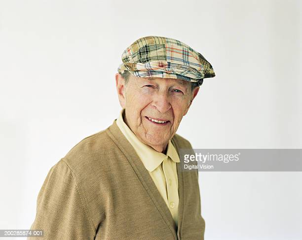 senior man wearing hat, smiling, portrait - cappello foto e immagini stock