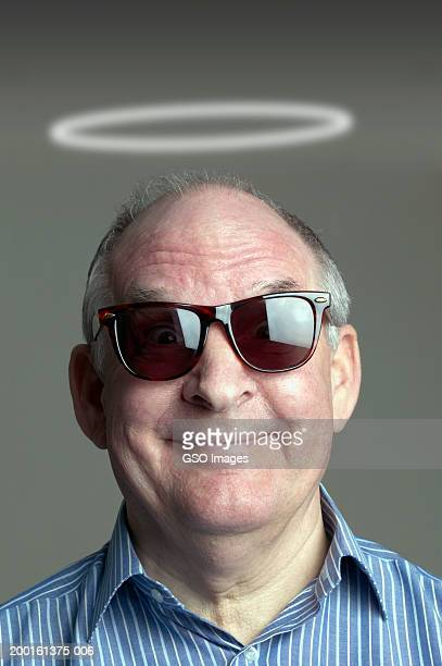 senior man wearing sunglasses with halo of light above head, portrait - angel halo stock pictures, royalty-free photos & images