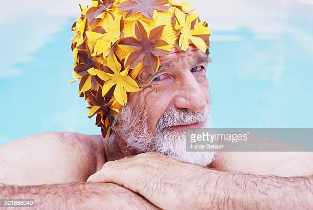 Senior man wearing swimming cap