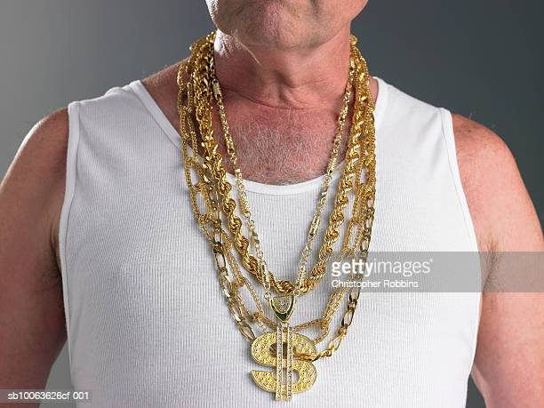 senior man wearing tank top and gold chains with dollar sign, mid section - bling bling stock pictures, royalty-free photos & images