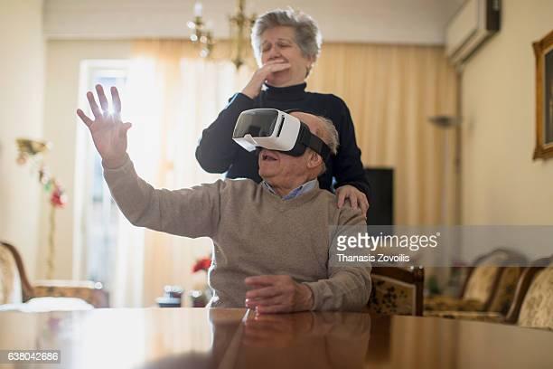 Senior man wearing virtual reality glasses