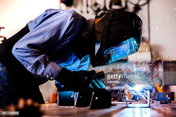 senior man welding in workshop - in flames i the mask stock pictures, royalty-free photos & images