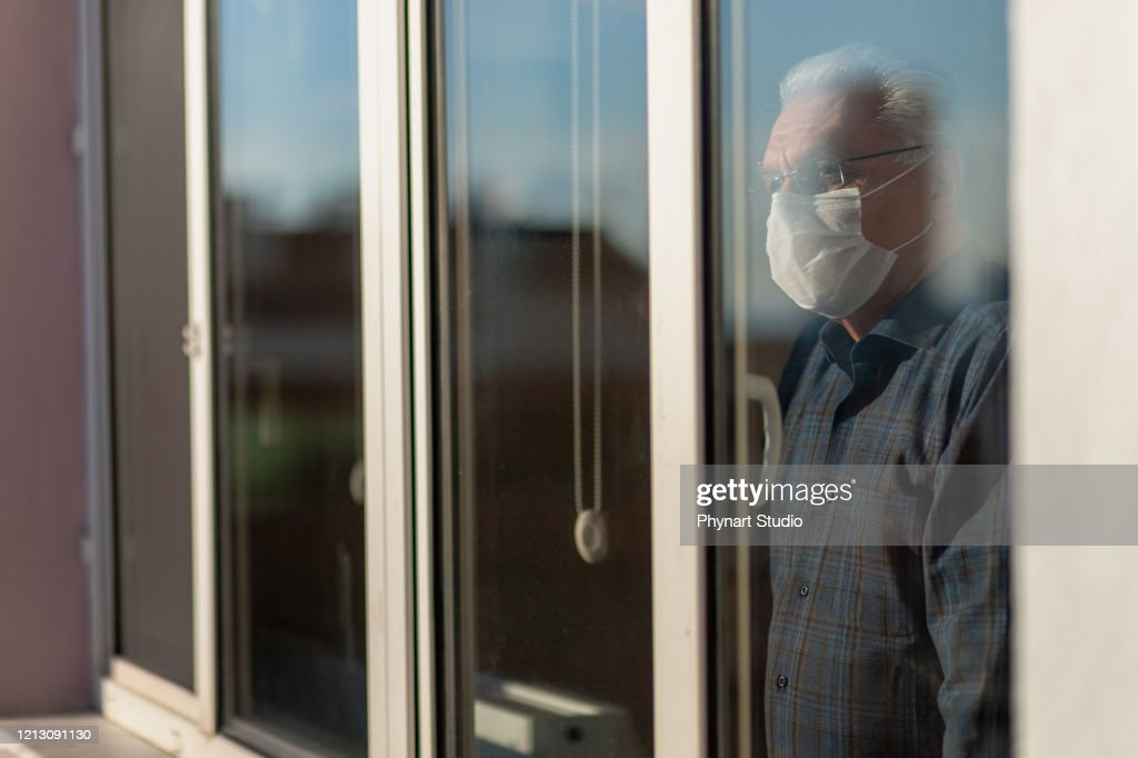 senior man who cannot leave the house due to an epidemic : Stock Photo