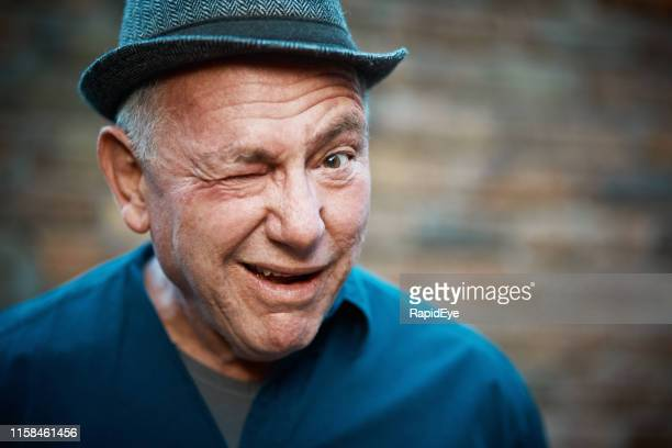 senior man winks lewdly - eyes wide shut foto e immagini stock