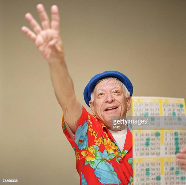 Senior man winning at bingo
