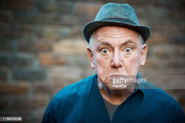 senior man with a comical look of surprise - comedian stock pictures, royalty-free photos & images
