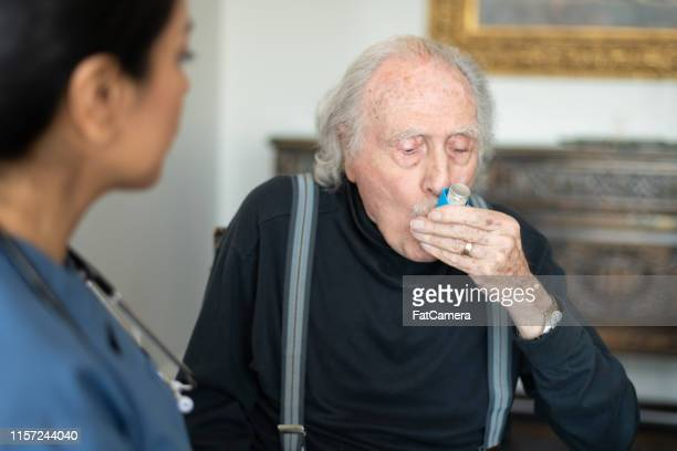 senior man with a puffer - chronic illness stock photos and pictures