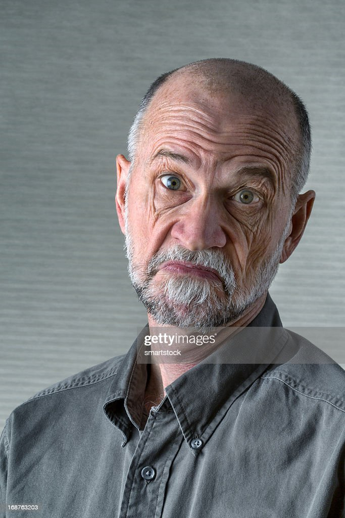 Senior Man With a What do I Care Expression : Stock Photo