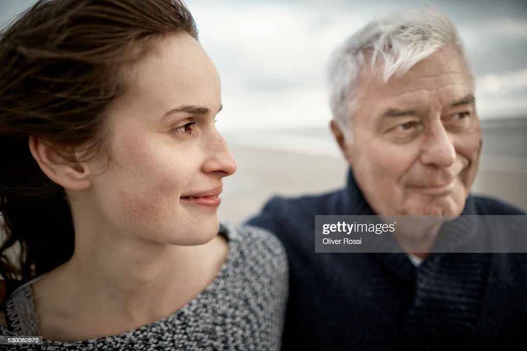 Senior man with adult daughter on the beach : Stock Photo