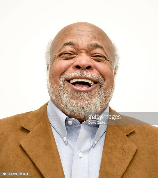 senior man with beard laughing, close-up, portrait - black people laughing stock photos and pictures