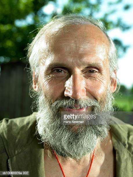 Senior man with beard smiling, close-up, portrait
