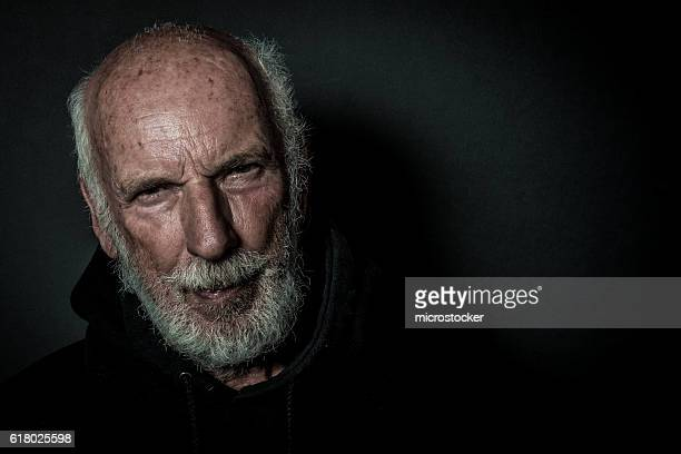 senior man with beard with lonely and sad expression - ominous stock photos and pictures