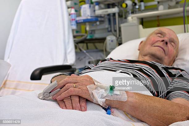 senior man with cannulae and band-aid being in intensive care after heart attack - one senior man only stock pictures, royalty-free photos & images