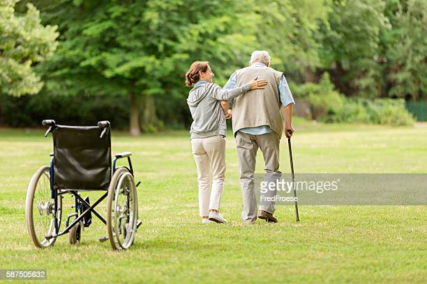 Senior man with caregiver at the park
