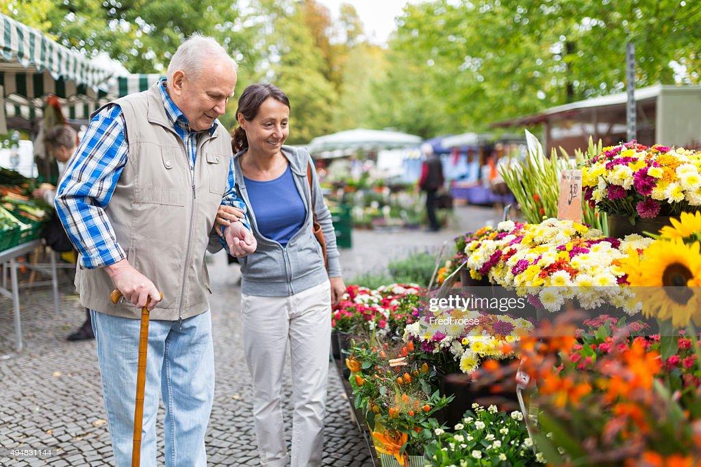 Senior man with caregiver shopping : Stock Photo