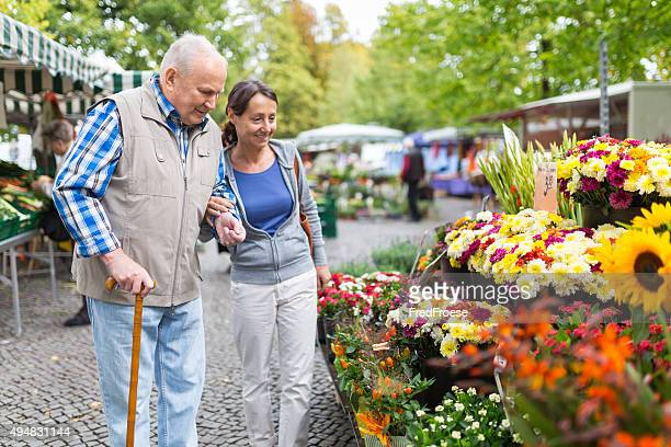 Senior man with caregiver shopping