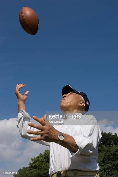 a senior man with  foin a park - つかまえる ストックフォトと画像