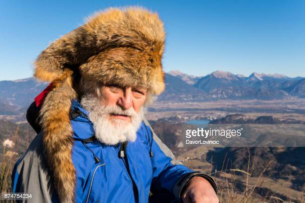 Senior man with Fox Kuchma on top of  mountain