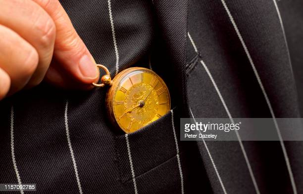 senior man with gold pocket watch - anticipation stock pictures, royalty-free photos & images