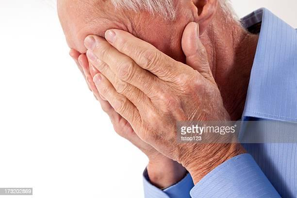 Senior man with head in hands. Sad, depressed, hopeless, despair.