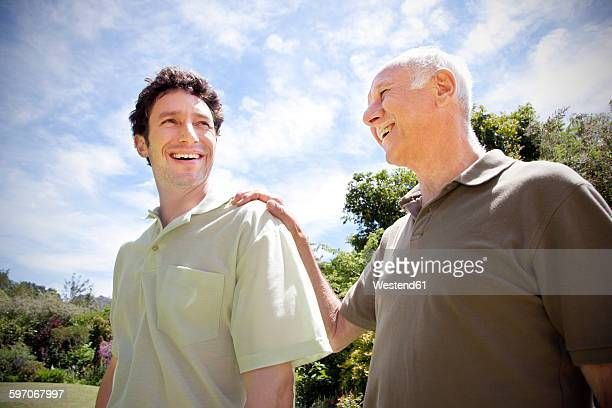 Senior man with his adult son in the garden