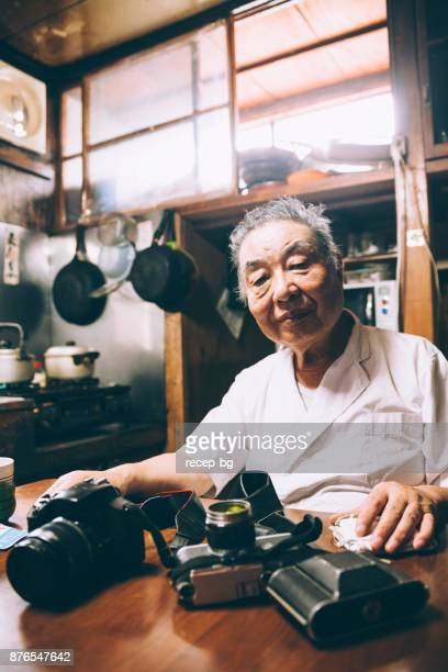 senior man with his cameras - photographic film camera stock photos and pictures