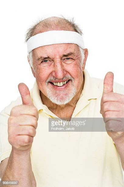 Senior man with his thumbs up.
